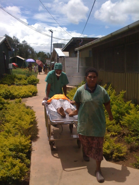 Photo: C Houston, MSF |  Nursing Officer Norman and Betty move a patient