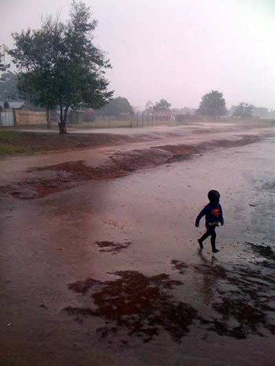 Photo: Eamonn Vitt | Ugandan Superboy in the Rain.