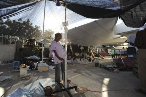 Medical care under tents continues in front of what was La Trinité trauma hospital and rehabilitation centre.