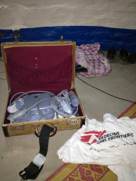The portable ultrasound kept safe and secure with a few MSF t-shirts as padding © Raghu Venugopal