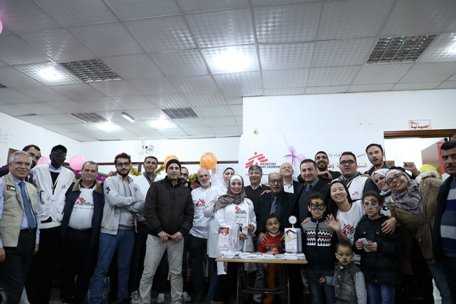 Images shows the team gathered together, many in MSF t-shirts and big smiles, at the celebration
