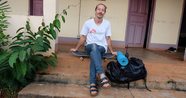MSF doctor Alexander Nyland sits with his skateboard outside the MSF house in Bangui, Central African Republic