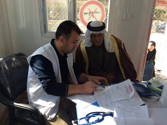 An MSF doctor consults with a patient at the new clinic in Iraq