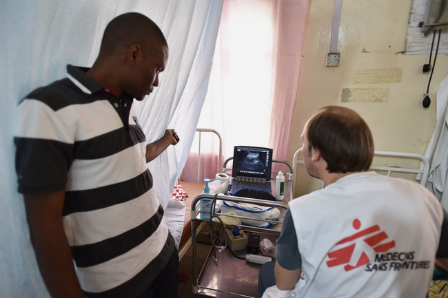 Photo of MSF's Dr Uche Daniel and Dr Carlos Pilasi, conducting an ultrasound on a patient prior to obstetric surgery.