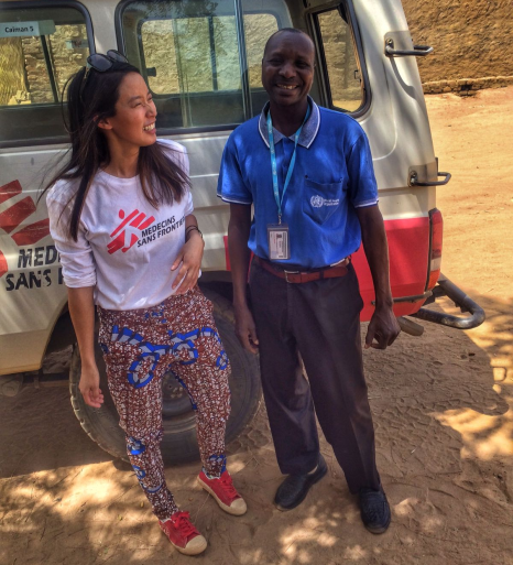 Alexandrar Chen and Dr. Abdoulaye stand by a van laughing