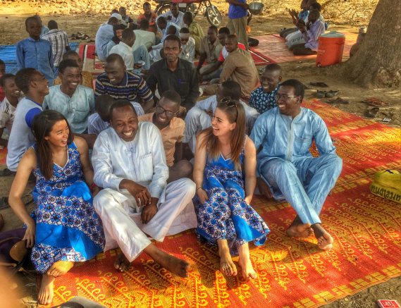 Group of people sitting around at a wedding in Chad