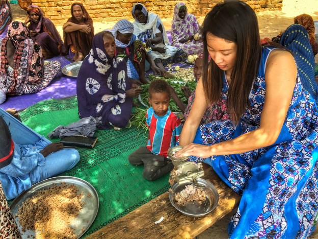 Helping prepare food for a Chadian wedding – grinding up onions and beef
