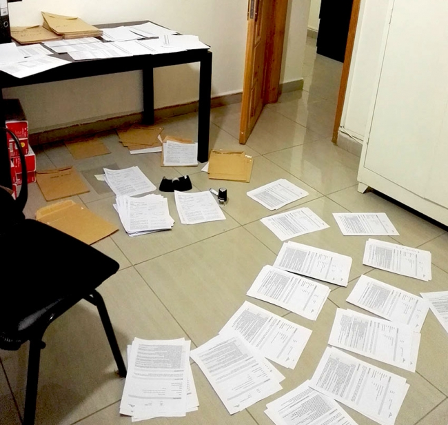 contracts covering the table and the floor