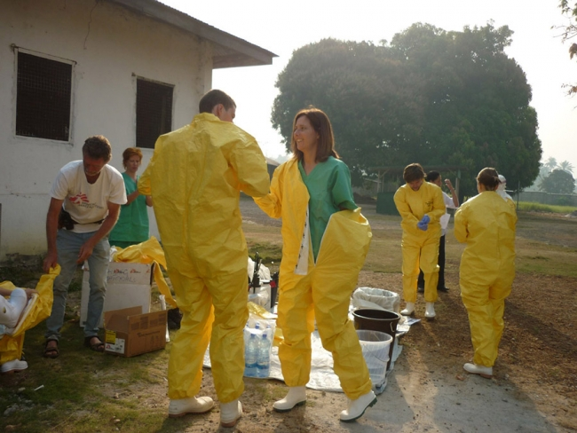 Daniela and the team practise wearing their protective suits, in case of another outbreak of Ebola. She reports there are currently no new cases where she is in Sierra Leone.