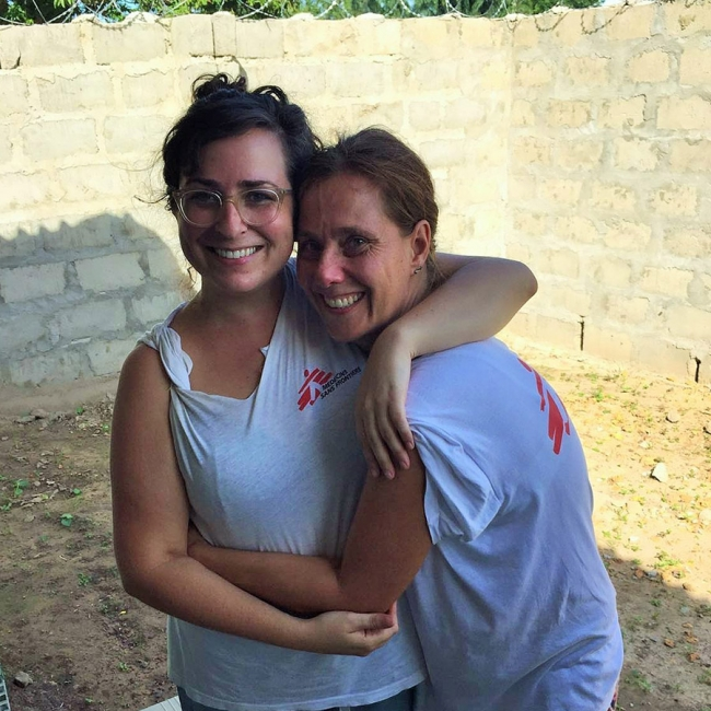 Daniela and her colleague Maura share a hug