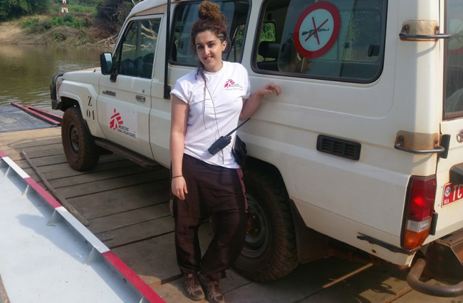 Nurse Dea stands by an MSF Land Cruiser