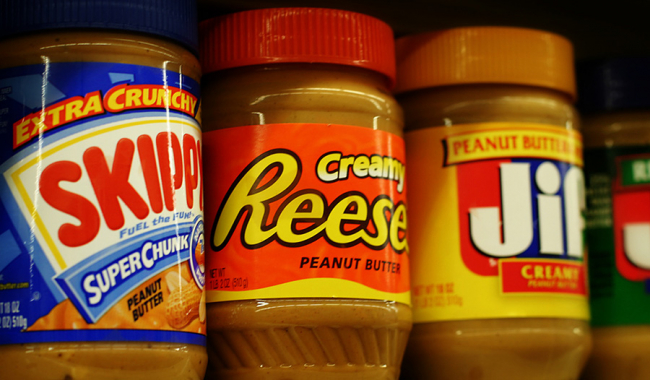 a row of different types of peanut butter