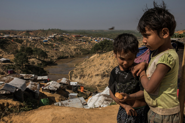 Image shows two young Rohingya children in a camp in Bangladesh