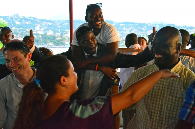 The MSF team celebrate the end of Ebola at MSF Spain's office in Freetown.