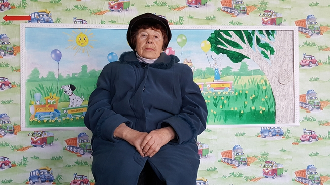 77-year-old Sazonova Galina waiting to be seen by a doctor at MSF's mobile clinic in Pavlopil, Ukraine.