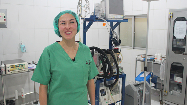 Image shows Kanya, the gynaecologist, in her green hospital scrubs