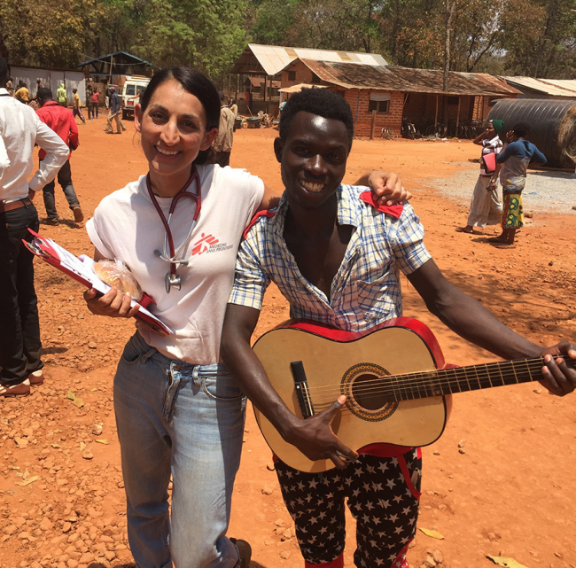 A member of the MSF health promotion team smiles with his guitar
