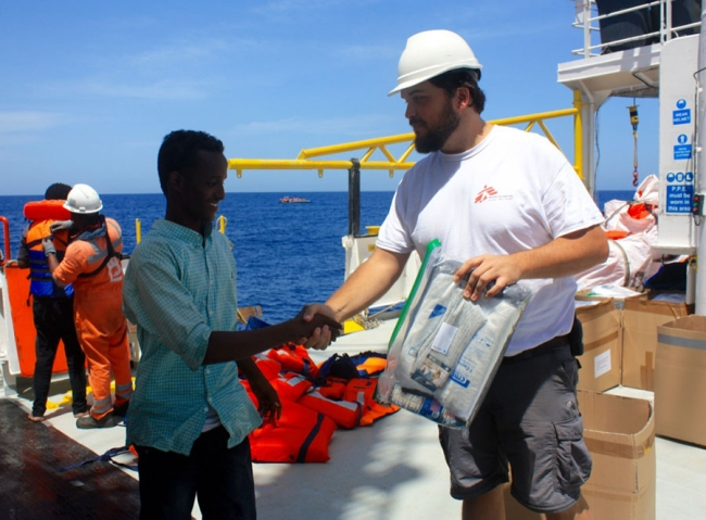 Haydn shakes hands with one of the people who have been rescued