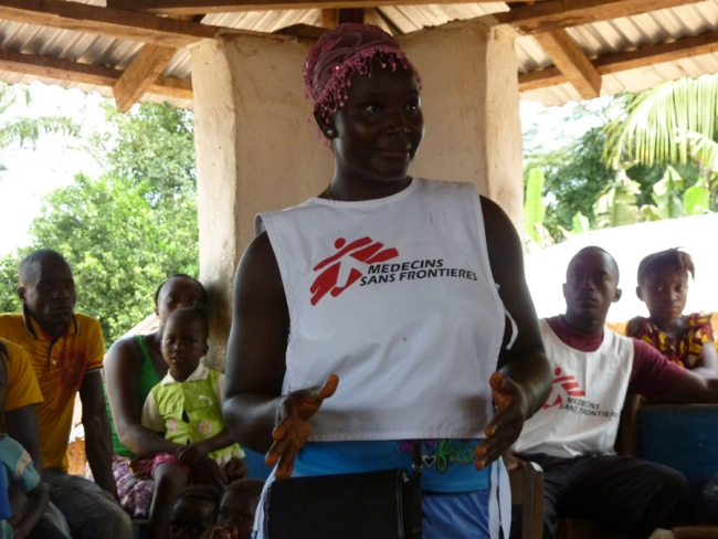 Deboriah S. Foko, an MSF Ebola awareness health promoter answers questions during a community visit. Foya district, Liberia.