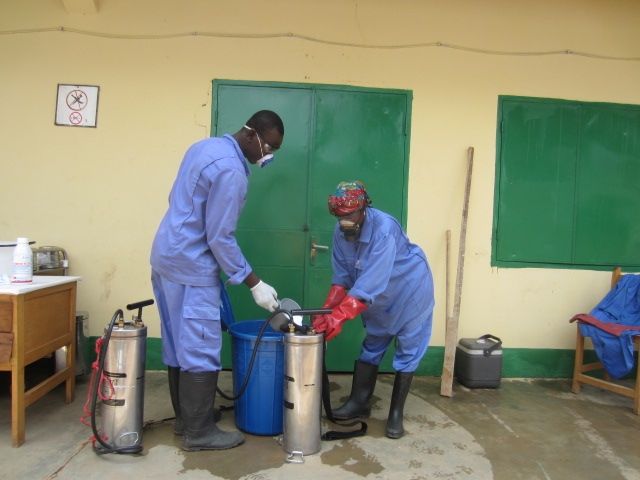 The team prepare to spray the hospital