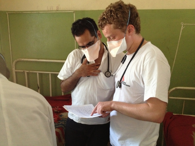 Raghu (L) on the ward in MSF's hospital in Am Timam