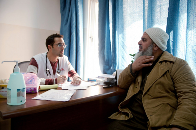 Image shows a doctor and patient together