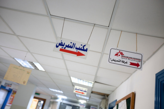 Images shows signs in Arabic pointing to the MSF / Doctors without Borders non-communicable diseases clinic in Irbid, Jordan