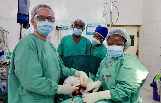 Image shows Jared & team performing an operation