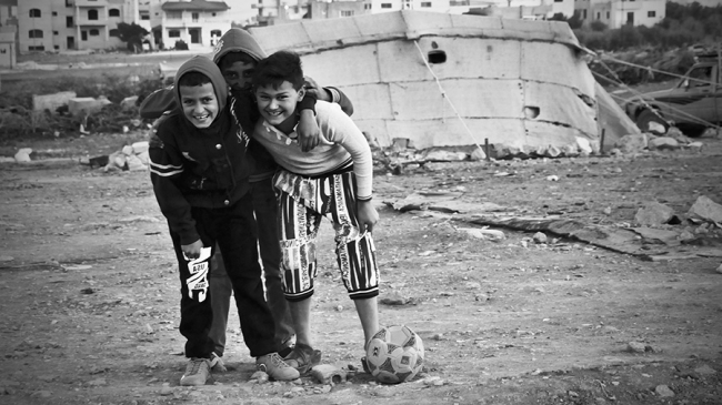 Mahmoud and his friends play football.