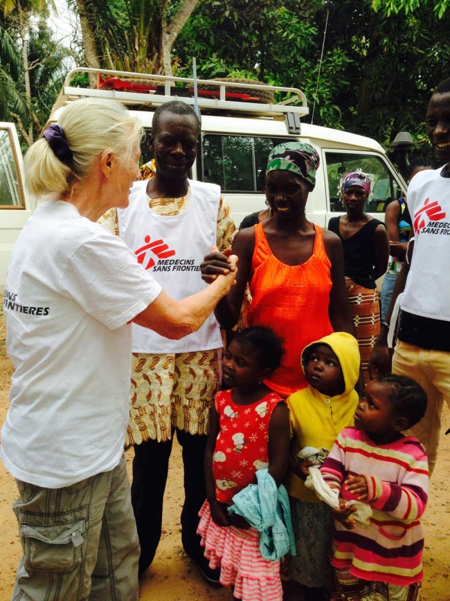 Mama Sesay and her grandchildren with a member of our health promotion team and driver ©Alison Criado-Perez/MSF