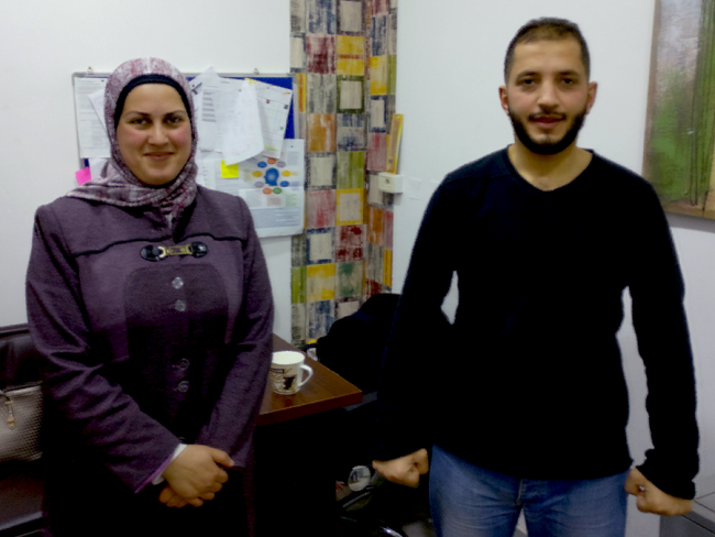 Image shows two of MSF's mental health counsellors in Irbid, Jordan: a man in a black top and jeans, and a woman in a purple jacket and hijab