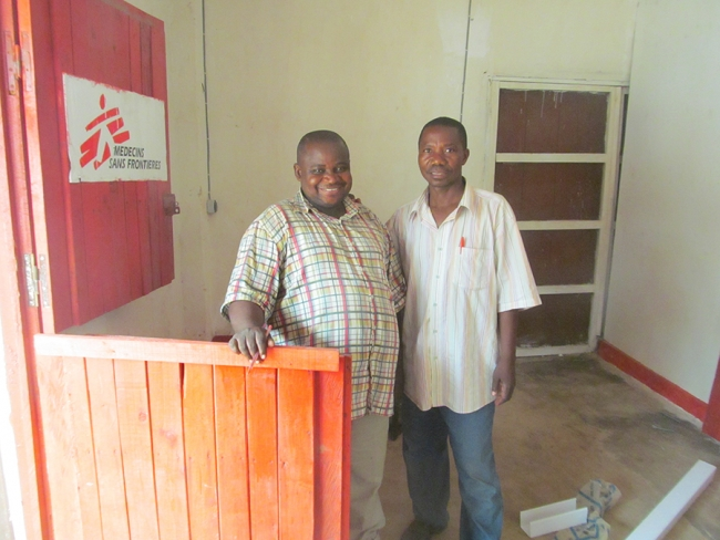Michel and Bita, two pharmacy supervisors at the entrance to the new pharmacy, a few days before we moved in.