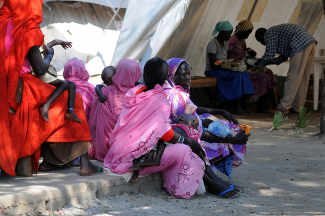Mothers and children wait to be seen at the old MSF tent in Doro refugee camp.