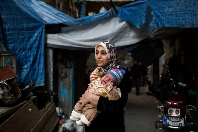 A mother with her baby outside the maternity unit in Shatila Refugee Camp