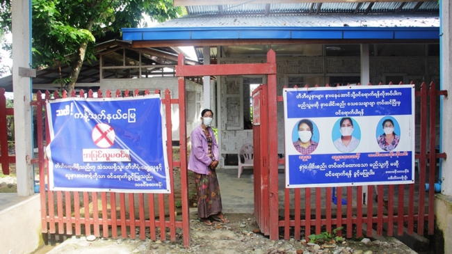 An MSF clinic in Myanmar, with signs showing the curling letters of the Burmese alphabet