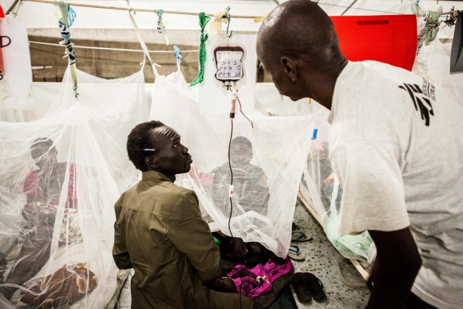 Blood transfusions underway for malaria patients with anemia. Blood is collected on site by family donors whose blood is tested for Malaria, Syphilis, Hep B and C, HIV and blood grouping.