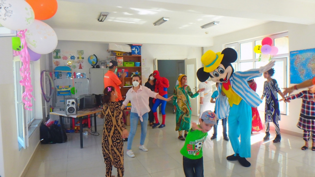 people dressed as cartoon characters entertain children at the paediatric tuberculosis hospital in Tajikistan