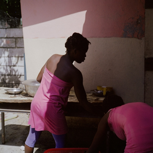 Woman silhouetted in shadow at a clinic for survivors of sexual and gender based violence in Haiti