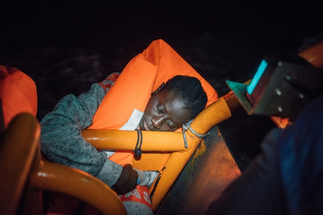 A woman in a lifejacket on board the Aquarius