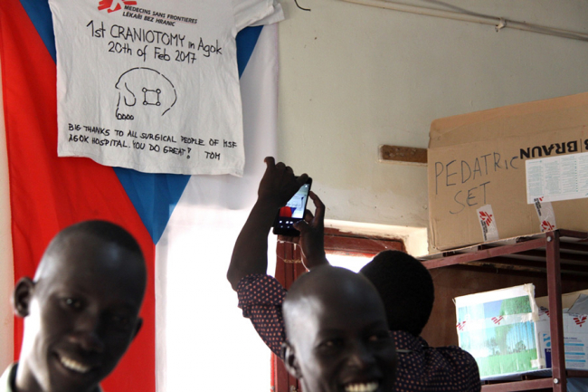 The surgical team in Agok, South Sudan, celebrate their first successful craniotomy.