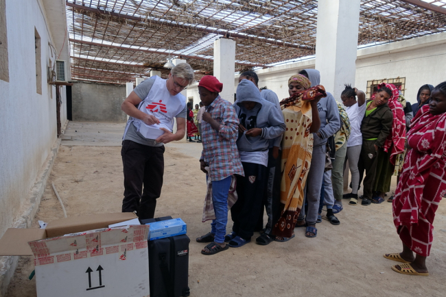 People in the Libyan detention centre line up for a medical consultation with Tankred.