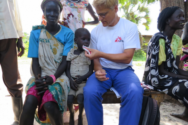 Tankred with a young malnourished patient in South Sudan.