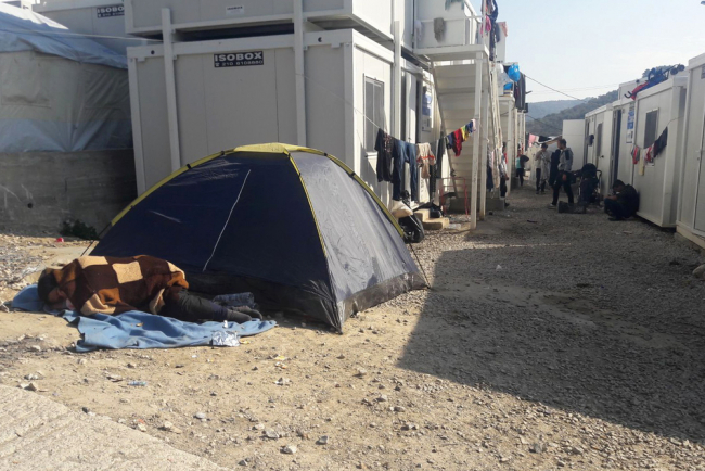 image shows tents and containers at moria camp