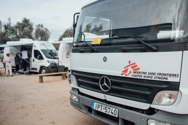 Image shows trucks with MSF logos - the mobile clinic