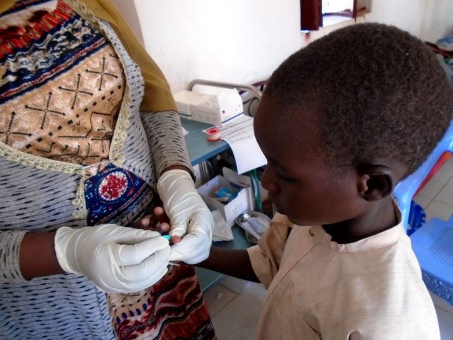 A small boy is tested for malaria in an MSF clinic in Darfur