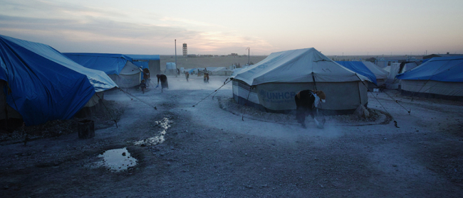 The white tents with blue tarpaulins at the camp for displaced people in Ain Issa, Syria
