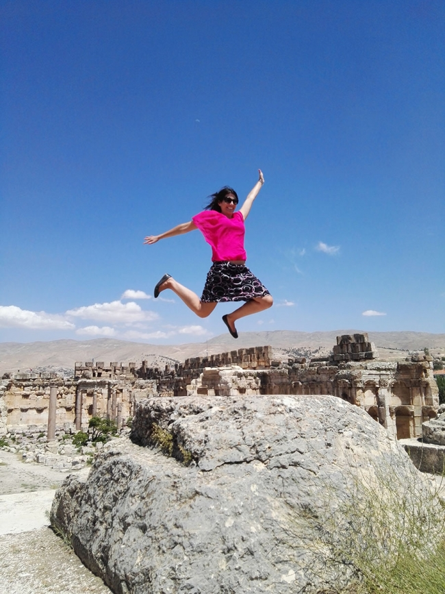 Nicole leaping, in the sunshine in Lebanon
