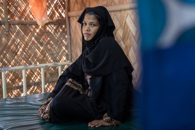 Image shows a young Rohingya woman wearing a black headscarf at an MSF clinic in Bangladesh