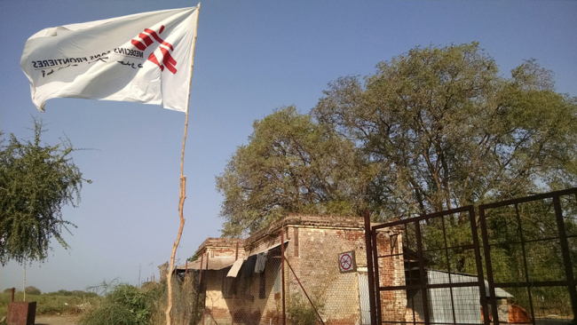 Image shows the MSF flag flying over the hospital in Old Fangak