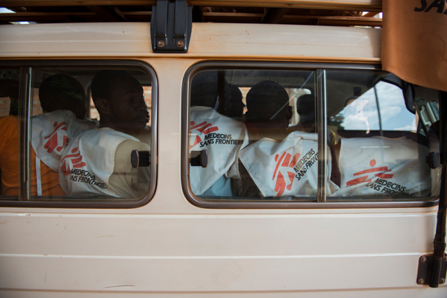 Image shows an MSF land cruiser packed with staff all wearing MSF uniforms